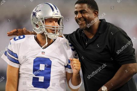 Tony Romo, Greg Ellis. Dallas Cowboys quarterback Tony Romo receives a hug from former Cowboys' player Greg Ellis before an NFL preseason football game, in Arlington, Texas