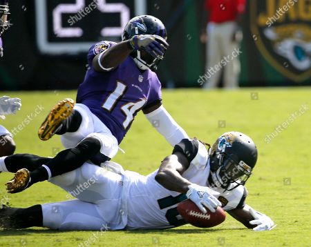 Denard Robinson, Devin Hester. Jacksonville Jaguars' Denard Robinson (16) recovers a fumble on a punt as Baltimore Ravens' Devin Hester (14) tires to stop him during the second half of an NFL football game in Jacksonville, Fla