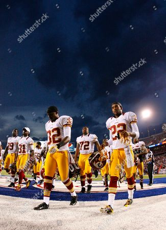 Brandyn Thompson, Kevin Barnes. Washington Redskins' Brandyn Thompson (32) and Kevin Barnes (22) walk off the field during an NFL game against the Buffalo Bills in Orchard Park, N.Y
