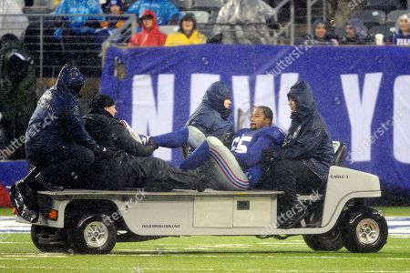Stock Picture of New York Giants' Will Beatty is driven off the field after fracturing his right leg during the second half of an NFL football game against the Washington Redskins, in East Rutherford, N.J