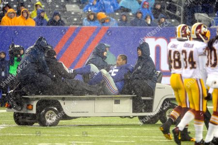 New York Giants' Will Beatty is driven off the field after fracturing his right leg during the second half of an NFL football game against the Washington Redskins, in East Rutherford, N.J