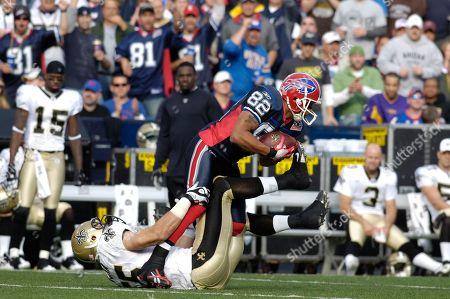 Josh Reed, Scott Fujita. Buffalo Bills wide receiver Josh Reed is tackled by New Orleans Saints linebacker Scott Fujita during a NFL football game in Orchard Park, N.Y. on