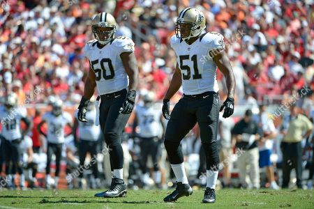Curtis Lofton, Jonathan Vilma. New Orleans Saints middle linebacker Curtis Lofton (50) and linebacker Jonathan Vilma (51) wait for a play during the first half of an NFL football game in Tampa, Fla