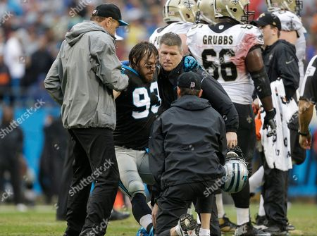 Carolina Panthers' Chase Blackburn (93) is helped off the field in the second half of an NFL football game against the New Orleans Saints in Charlotte, N.C