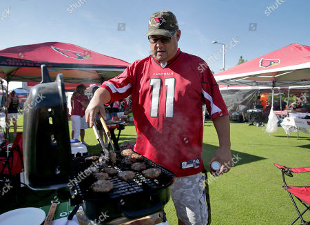 Arizona Cardinals fan Keith Hernandez tailgates prior to an football game against the Seattle Seahawks, in Glendale, Ariz