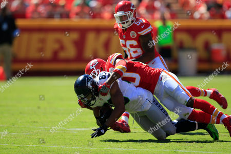 Steven Nelson, Doug Baldwin. Seattle Seahawks wide receiver Doug Baldwin (89) is tackled by Kansas City Chiefs defensive back Steven Nelson (20) during the first half of an NFL preseason football game in Kansas City, Mo