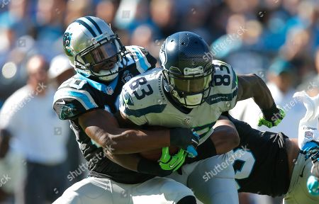 Ricardo Lockette, Antoine Cason. Seattle Seahawks wide receiver Ricardo Lockette (83) is tackled by Carolina Panthers cornerback Antoine Cason (20) during an NFL game at the Bank of America Stadium in Charlotte, N.C. on