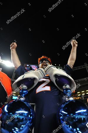 Bronco fan Bobby Willis of Farmington, NM shows his support for the home team before the Broncos play the Pittsburgh Steelers during the NFL football game, in Denver