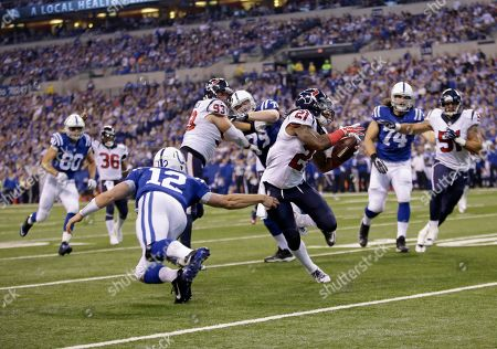 Kendrick Lewis, Andrew Luck. Houston Texans free safety Kendrick Lewis, right, gets past Indianapolis Colts quarterback Andrew Luck on his way to the end zone for a touchdown on a interception during the first half of an NFL football game in Indianapolis