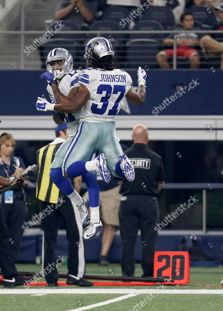 Nick Harwell, Gus Johnson. Dallas Cowboys running back Gus Johnson (37) celebrates his touchdown against the Houston Texans with wide receiver Nick Harwell (17) during the second half of a preseason NFL football game, in Arlington, Texas