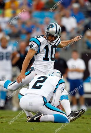 Olindo Mare, Nick Harris. Carolina Panthers kicker Olindo Mare (10) kicks a field goal as Nick Harris (2) holds the ball against the Houston Texans during the first half of a NFL preseason football game in Charlotte, N.C