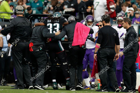 Philadelphia Eagles' Ron Brooks (33) is helped off the field during the first half of an NFL football game against the Minnesota Vikings, in Philadelphia