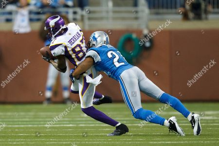 Tye Hill, Bernard Berrian. Detroit Lions cornerback Tye Hill (24) wraps up Minnesota Vikings wide receiver Bernard Berrian (87) in the first half of an NFL football game in Detroit, . Detroit defeated Minnesota 20-13