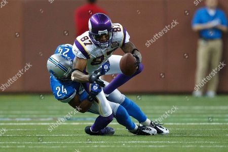 Bernard Berrian, Tye Hill. Minnesota Vikings wide receiver Bernard Berrian (87) is tackled by Detroit Lions cornerback Tye Hill (24) in the first half of an NFL football game in Detroit