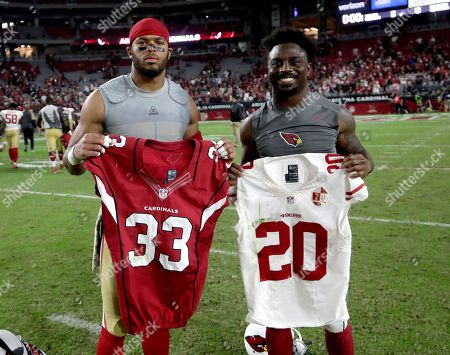 Stock Picture of San Francisco 49ers cornerback Marcus Cromartie, left, and Arizona Cardinals running back Kerwynn Williams, right, swap jersey's after an NFL football game, in Glendale, Ariz. The Cardinals won 23-20