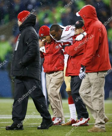San Francisco 49ers Mario Manningham is helped off the field after an injury against the Seattle Seahawks in the second half of an NFL football game, in Seattle
