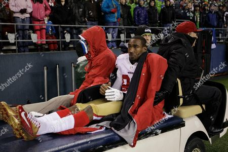 San Francisco 49ers' Mario Manningham (82) is taken off the field on a cart after suffering an injury in the second half of an NFL football game against the Seattle Seahawks, in Seattle