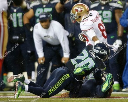 Jeremy Lane, Mario Manningham. Seattle Seahawks Jeremy Lane dives at San Francisco 49ers Mario Manningham in the second half of the play he was injured of an NFL football game, in Seattle