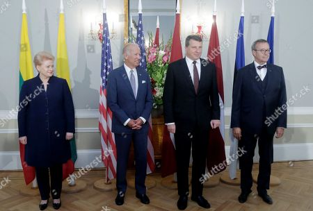 From left: Lithuanian President Dalia Grybauskaite, U.S. Vice President Joe Biden, Latvian President Raimonds Vejonis and Estonian President Toomas Hendrik Ilves pose for a photo during a press conference after their meeting in Riga, Latvia, . Biden has reaffirmed America's commitment to defending the Baltic nations of Latvia, Lithuania and Estonia against any threat from neighboring Russia