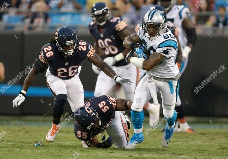 Steve Smith, Lance Briggs, Tim Jennings. Carolina Panthers' Steve Smith (89) runs through the tackle of Chicago Bears' Lance Briggs (55) and Tim Jennings (26) during the first half of a preseason NFL football game in Charlotte, N.C