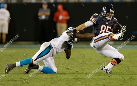 Melvin White, Gabe Miller. Chicago Bears' Gabe Miller, right, is tackled by Carolina Panthers' Melvin White, left, during the second half of a preseason NFL football game in Charlotte, N.C., . The Panthers won 24-17