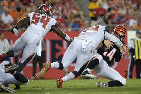 Andy Dalton, Lavonte David, George Johnson. Cincinnati Bengals quarterback Andy Dalton (14) gets sacked by Tampa Bay Buccaneers defensive end George Johnson (94) as outside linebacker Lavonte David (54) comes to help during the first half of a preseason NFL football game in Tampa, Fla