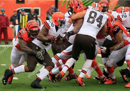 Vontaze Burfict, Willis McGahee. Cleveland Browns running back Willis McGahee (26) is tackled by Cincinnati Bengals outside linebacker Vontaze Burfict (55) in the first half of an NFL football game, in Cincinnati