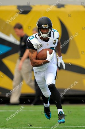 Jacksonville Jaguars wide receiver Kerry Taylor warms up prior to the the first half of an NFL football game against the Tampa Bay Buccaneers, in Jacksonville, Fla