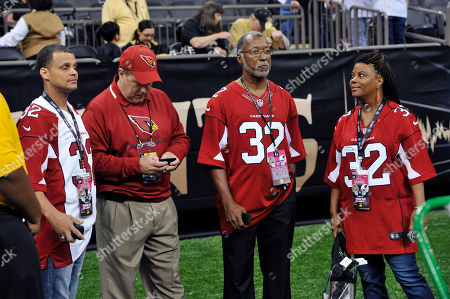 Tyrone Mathieu, Jr., Roger Neeling, Gerald Johnson, Sheila Mathieu. The family of Arizona Cardinals defensive back Tyrann Mathieu watch don the sideline before an NFL football game against the New Orleans Saints in New Orleans, . Left to right are his father Tyrone Mathieu, Jr., family friends Roger Neeling and Gerald Johnson, and mother Sheila Mathieu