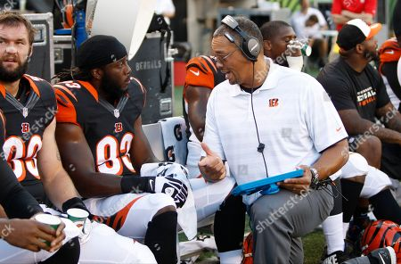 Will Clarke, Jay Hayes. Cincinnati Bengals defensive line coach Jay Hayes talks with defensive end Will Clarke (93) in the first half of an NFL preseason football game against the Indianapolis Colts, in Cincinnati
