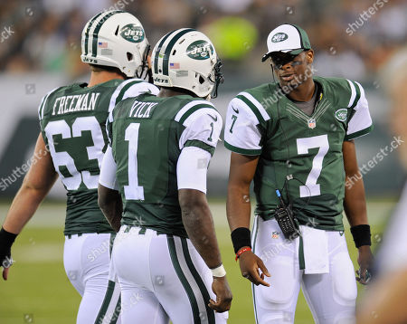 New York Jets quarterback Geno Smith (7) greets center Dalton Freeman (63) and quarterback Michael Vick (1) as they walk off the field in the second quarter of a preseason NFL football game, in East Rutherford, N.J
