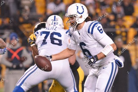 Indianapolis Colts quarterback Charlie Whitehurst (6) hands off against the Pittsburgh Steelers in the second half of an NFL football game, in Pittsburgh