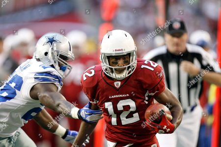 Andre Roberts, Abram Elam. Arizona Cardinals wide receiver Andre Roberts, right, is held back by Dallas Cowboys strong safety Abram Elam, left, in an NFL football game, in Glendale, Ariz