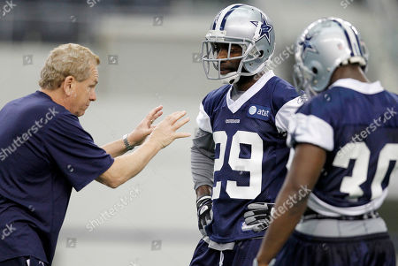 Dallas Cowboys defensive coach Dave Campo goes over a drill with cornerbacks Marquis Floyd (29) and Jamar Wall (30) during rookie mini-camp at Cowboys Stadium Arlington, Tx