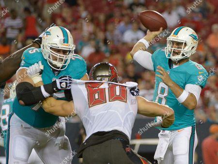 Miami Dolphins quarterback Matt Moore (8) throws a pass as guard Nate Garner (75) blocks Tampa Bay Buccaneers linebacker Scott Solomon (60) during the second quarter of an NFL preseason football game, in Tampa, Fla