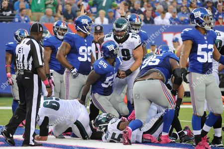 LeSean McCoy, Todd Herremans. Philadelphia Eagles guard Todd Herremans (79) blocks New York Giants' Keith Rivers (55) as LeSean McCoy (25) scores a touchdown during the first half of an NFL football game, in East Rutherford, N.J