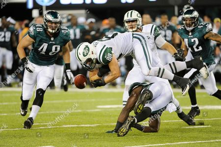 Konrad Reuland, Emmanuel Acho. New York Jets tight end Konrad Reuland (88) fumbles the ball after being hit by Philadelphia Eagles linebacker Emmanuel Acho, bottom, during the first half of a preseason NFL football game, in East Rutherford, N.J