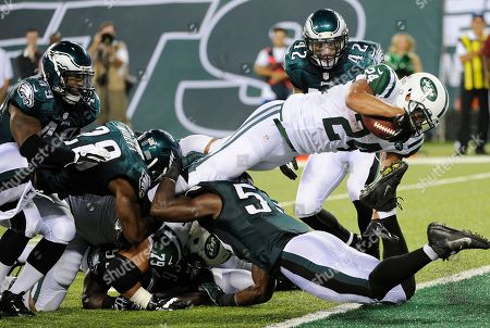 Kahlil Bell, Jake Knott. New York Jets running back Kahlil Bell, top, dives over Philadelphia Eagles linebacker Emmanuel Acho for a touchdown during the second half of a preseason NFL football game, in East Rutherford, N.J