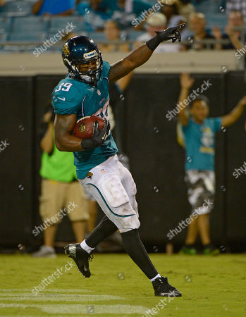Jacksonville Jaguars running back Richard Murphy celebrates a 5-yard touchdown run against the Atlanta Falcons during the second half of an NFL preseason football game, in Jacksonville, Fla. Jacksonville won 24-14