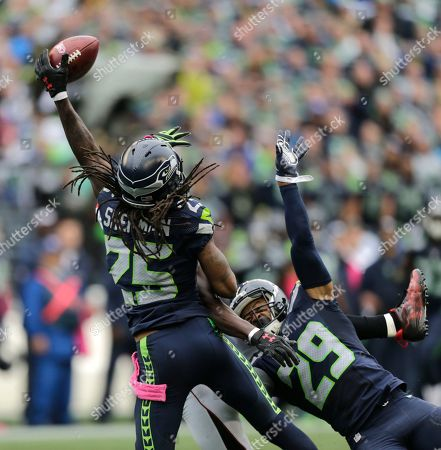 Richard Sherman, Earl Thomas. Seattle Seahawks cornerback Richard Sherman (25) and Earl Thomas (29) break up a pass intended for Atlanta Falcons wide receiver Julio Jones (obscured) in the second half of an NFL football game, in Seattle. The Seahawks beat the Falcons 26-24