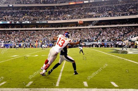 Ramses Barden, Nnamdi Asomugha. New York Giants wide receiver Ramses Barden (13) is called for a pass interference on Philadelphia Eagles cornerback Nnamdi Asomugha (24) during the second half of an NFL football game, in Philadelphia. The Eagles won 19-17