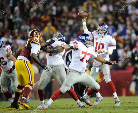Eli Manning, Jarvis Jenkins, James Brewer. New York Giants quarterback Eli Manning (10) passes against Washington Redskins defensive end Jarvis Jenkins (99) during the first half of an NFL football game, in Landover, Md. Also seen is New York Giants guard James Brewer (73