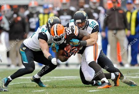 Paul Posluszny, Russell Allen, Willis McGahee. Jacksonville Jaguars middle linebackers Paul Posluszny (51) and Russell Allen (50) stop Cleveland Browns running back Willis McGahee (26) in the first quarter of an NFL football game in Cleveland