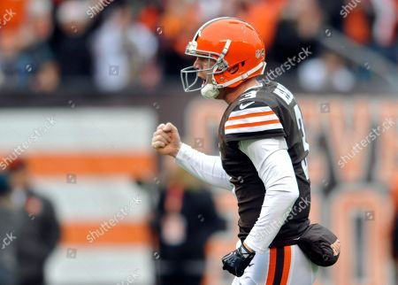 Cleveland Browns quarterback Brandon Weeden celebrates after a 1-yard touchdown run by running back Willis McGahee in the first quarter of an NFL football game against the Jacksonville Jaguars in Cleveland