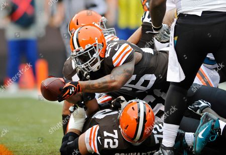 Cleveland Browns running back Willis McGahee (26) stretches into the end zone on a 1-yard touchdown run against the Jacksonville Jaguars in the fist quarter of an NFL football game in Cleveland