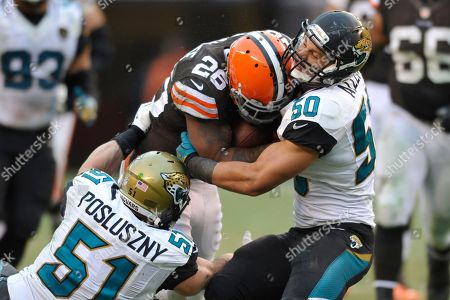 Paul Posluszny, Russell Allen, Willis McGahee. Jacksonville Jaguars middle linebacker Paul Posluszny (51) and outside linebacker Russell Allen (50) tackle Cleveland Browns running back Willis McGahee (26) during an NFL football game, in Cleveland. Jacksonville won 32-28