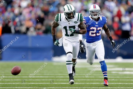 Braylon Edwards, Aaron Williams. New York Jets wide receiver Braylon Edwards (17) and Buffalo Bills cornerback Aaron Williams (23) watch as the ball bounces away during the second half of an NFL football game, in Orchard Park, N.Y