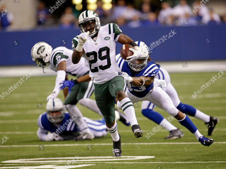 Dwight Lowery, Bilal Powell. New York Jets running back Bilal Powell (29) breaks away form Indianapolis Colts free safety Dwight Lowery (33) in the second half of an NFL football game in Indianapolis