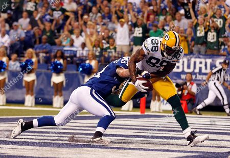 Pat Angerer, Jermichael Finley. Green Bay Packers tight end Jermichael Finley catches a touchdown pass as he's tackled by Indianapolis Colts linebacker Pat Angerer during the first quarter of an NFL preseason football game in Indianapolis