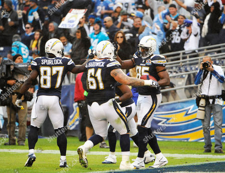 Antonio Gates, Micheal Spurlock, Nick Hardwick. San Diego Chargers tight end Antonio Gates (85) is congratulated by Micheal Spurlock (87) and Nick Hardwick (61) after scoring a touchdown during the second half of an NFL football game against the Carolina Panthers, in San Diego